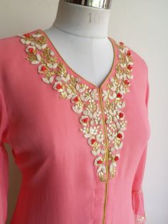 "Pink Kurta with Front Open Design delicately embroidered with Pearl and Thread work, has slightly gathered sleeves with Frill Detailing Paired here with our Foil Print Jute Cotton Skirt which you can buy from the ""Lowers"" Collection Embroidery On Kurtis, Hand Embroidery Dress, Kurti Embroidery Design, Embroidery Suits, Embroidery Patterns, Kurti Neck Designs, Dress Neck Designs, Blouse Designs, Indian Dresses"
