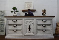 Large dresser painted white, distressed with black glaze and stained top. www.thewoodspa.com
