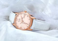 BUREI® Women's BL-3023-01AR Mother-Of-Pearl Rose Gold Watch with White Leather Band Price:$45.99