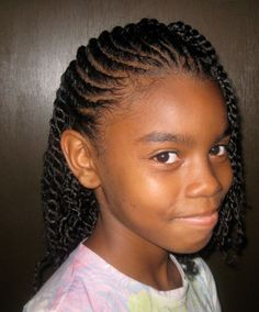 Hair is flat twisted to the side and loose two strand twist throughout the rest of the head.