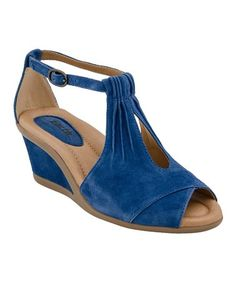 4fb647f682cb The Earth Caper features fabulous lines and gorgeous pleated suede -  complete with keyhole cutout and petite ankle strap. This wedge has a  sultry appeal.