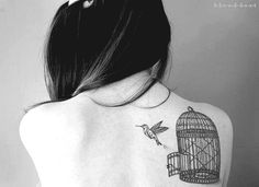 I love, love, love this birdcage, but I'm thinking a different type of bird.  #Oh yeah bird tattoos!