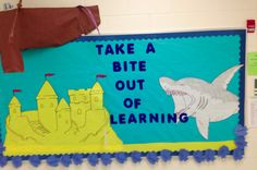 Under water themed bulletin board. Hand drawn shark and castle with a boat made from cardboard