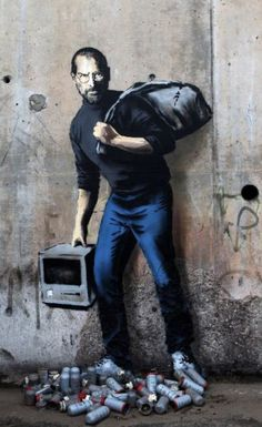 graff de Banksy qui rappelle que Steve Jobs était le fils d. The Banksy graffiti who recalls that Steve Jobs was the son of a Syrian migrant. Banksy - Calais Banksy graffiti who recalls that Steve Jobs was the son of a Syrian migrant.