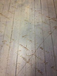 love poem stenciled on floor
