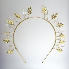 This striking ethereal crown is hand made using fine rock crystal quartz, and delicate golden leaves. Each piece is a unique, one of a kind creation, inspired by nature, made with attention, and using natural materials.  Ideal for a wedding or ball, this individual headpiece can be treasured forever and handed down through generations. It is beautiful enough to be displayed as an eternal reminder of your day. Quartz is quite possibly the most fascinating mineral on the planet. It comes in…
