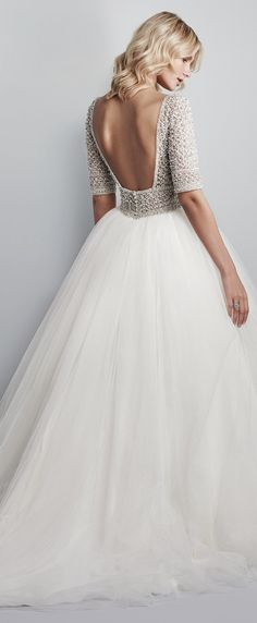 Allen Wedding Dress by Maggie Sottero | a show-stopping ballgown features a sheer bodice of Swarovski crystals and beading atop a voluminous tulle skirt | #weddingdress #bridalgown