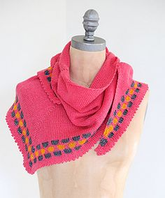 This simple shawl with a punchy border utilizes stranding to create literal colorblocks. Totally on trend, the picot edge adds a sweet touch.