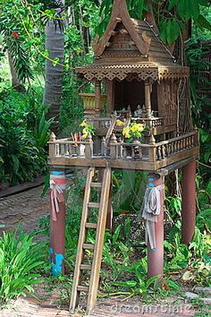 Thai Spirit House | traditional Thai spirit house made of wood in a garden.