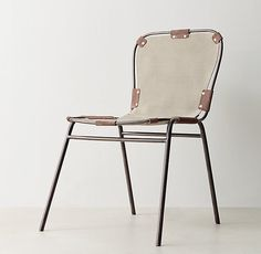 RH TEEN's Cato Desk Chair:Our desk chair's slender silhouette belies its sturdy constitution. Built of bent metal tubing, its taut frame supports a comfortable and durable canvas sling secured with riveted sueded-leather braces.