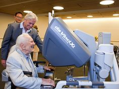 Star Tracks: Friday, July 3, 2015 | MAN VS. MACHINE | On Thursday, Kirk Douglas, with son Michael looking on, takes the controls of a surgical robot that he and wife Anne donated to Children's Hospital Los Angeles. The machine, made possible by a $2.3 million gift to the hospital, allows doctors to perform operations on infants using extra-small incisions.