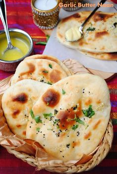 Butter Garlic Naan - If you love Indian food then this is a must have recipe!  It's a little involved but soooo goood in the end!  I travel to India at least once a year and when I'm home in the States I dream of the naan and butter chicken I'm missing in India!  This is a great recipe for butter naan!