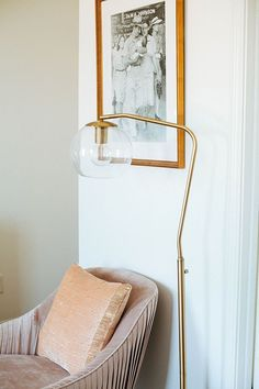 pink velvet chair + gold floor lamp