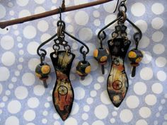 Kalahari Road Trip tin earrings, distressed, adorned, on vintage chain and hammered steel with recycled glass African beads. $32.00, via Etsy.