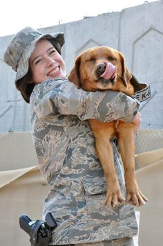 fox red Labrador retriever? Senior Airman Samantha Baker, 380th Expeditionary Security Forces Squadron a military working dog handler, and her partner Penny, a former Marine Corps independent detector dog