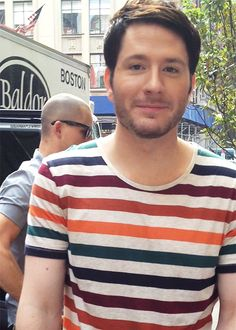 Adam Young - Owl City. His shirt reminds me of zebra stripes :D