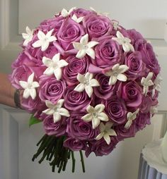 Bride bouquet of 40 lavender coolwater roses and stephanotis.
