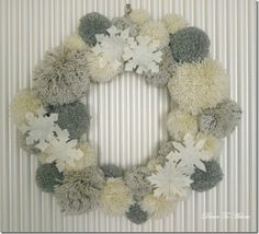 Winter wreath--White yarn pom pom wreath. Snowflakes for Christmas holiday DIY decorative wreath for front door.