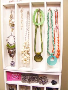 Use silverware trays to hang jewelry! Spray paint the trays (from walmart) and use hooks to hold everything :) including hooks on the bottom for longer necklaces! You could hang a bunch...one on top of the other to create more space!