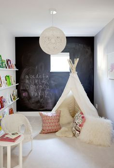 Kid's teepee playroom and chalkboard wall