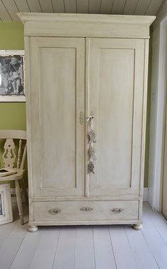 We love this solid pine antique wardrobe. The pretty ornate handles and bun feet really make this a stunning piece. We've highlighted its beauty with Farrow & Ball Barely White paint, lightly distressed and applied dark wax to age. Want a statement piece for your bedroom which great storage ... look no further!