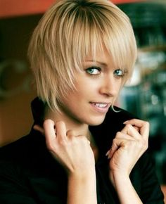cute short hairstyle with bangs beautiful woman for sure....
