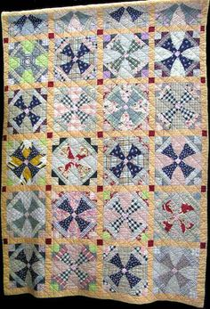 This Iron Cross quilt is very scrappy and most likely made in the 1940's. Hand pieced and Hand Quilted, owned by Jean Cloyd
