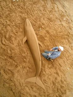 An amazing Blue Whale sand sculpture on Paignton beach, South Devon