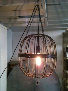 - Looking for one like this but bigger for outside on my front porch, any suggestions about where to look?    Industrial Welded Hanging Light Fixture. $120.00, via Etsy.