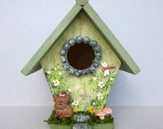 This little garden cottage mini birdhouse is a wonderful addition for your spring and summer decor. It has tree bark trim over the door, a watering can and a bee buzzing around the flowers. There is also a nice shade tree in the back of the house. There is a cord for hanging. A great idea for a gift. An original signed creation.  Not designed for outdoor use or for children.  Thank you for visiting my shop. .