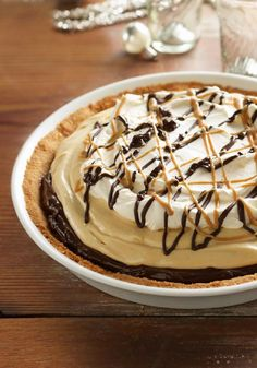 Mile-High Peanut Butter Pie -- What's better than layer upon layer of chocolate and creamy peanut butter? A dessert made of the same, with (even more) warm chocolate and PB drizzled on top.