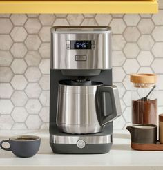 At GE Appliances, we're bringing craftsmanship to your countertops, with reliable and durable drip coffee makers. Equipped with either a sleek glass or insulated thermal carafe, our coffee makers have convenient functions such as Delayed Start and Timer, to make the brewing process simple and user-friendly. And all GE Appliances drip coffee makers are finished with tasteful and durable stainless steel, making them the perfect accent for any kitchen or office – all from a brand you trust. Thermal Coffee Maker, Best Coffee Maker, Drip Coffee Maker, Stainless Steel Coffee Maker, Coffee Type, Carafe, Cool Kitchens, Cool Things To Buy, Kitchen Appliances