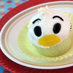 Donald's Just Ducky Cupcakes | We all know Donald can be a cantankerous duck, but these cute candy-billed cupcakes are inspired by his sweet side. Serve them at a birthday party or make a batch for a quick-and-easy everyday dessert.