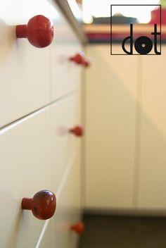 Red ceramic knobs - these are quite massive and look great in vibrant colors.   DOT biżuteria dla mebli: realizacje z naszymi produktami