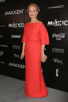 18 chicest mother of the bride style icons: Carolina Herrera stands out in a classic and clean red gown.