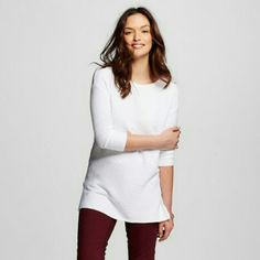 Merona 3/4 Sleeve Tunic Sweater Sweater features a round neck and long sleeves. Long length and ribbed fabric. Sweater has two small side slits (bottom edges) which add a little more comfort. Lightweight, great as a summer night top 53% cotton 40% rayon 7% Nylon Merona  Tops