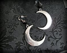 A stunning pair of crescent moon earrings made up from antique silver plated crescent moon charms, black glass crystal beads on antique silver plated earrings hooks. Lead and nickel free Earrings measure approx 2.6 inches long.