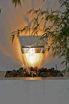 Modern water blade at night with lighting makes a simple effective feature. Repined by www.claudiadeyongdesigns.com