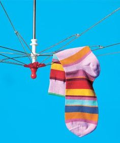 Air-dry laundry. When a worn out umbrella has lost the capacity to fend off raindrops, cut away the fabric and hang the frame upside down from a rod or a door knob. Clip damp delicate items to the ribs with clothespins.