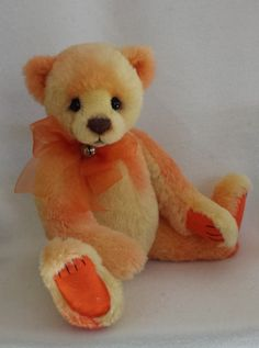 This bear is made with hand dyed alpaca. He is fully jointed with German glass eyes.