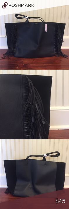 Victoria's Secret Black Tote Bag Large black tote bag, sides are suede with faux leather middle section. Leather fringing on front. Never used, very spacious on the inside! Victoria's Secret Bags Totes