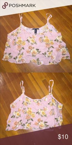 SALE 💕 NWOT Pink Crop Top Pink floral Crop Top that has never been worn. It flows and has adjustable straps. The fabric wrinkles easily and is 100% Rayon. Forever 21 Tops Crop Tops