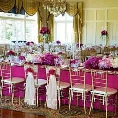 Three types of centerpieces topped the tables: short and full ones, more petite ones in collected milk glass vases and tall candelabras filled with blooms.