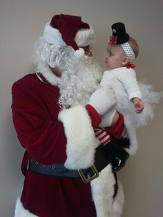 My Chloe in her snowman tutu I made her meeting Santa for her first time!