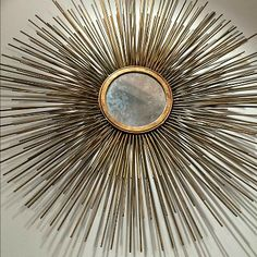 Offering a fresh approach to upscale interior design, Modern History is, as its name implies, a skillful blend of classic and modern styles. Showcased in the Triple Spike Mirror are three varying sized layers of brass spikes encircling a round reflective center. Create a stylish interior living space in your home or office with this stunningly chic wall accessory!