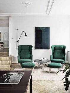 Multiple floor levels, 	herringbone parquet floor, high armchairs, solid colour on neutral background <3