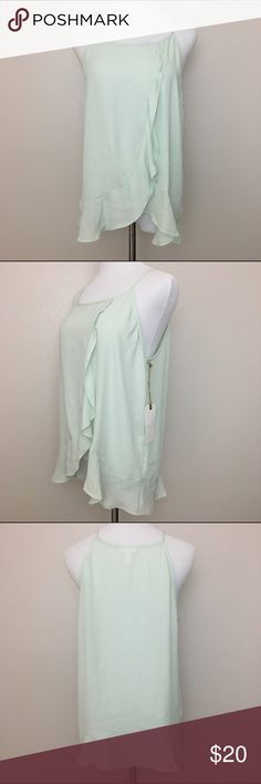 """NWT Leith sleeveless ruffled top, seafoam green, L New with tag Leith sleeveless ruffled top. Seafoam green color.  Fabric is 100% polyester. Machine washable.  Size Large Armpit to armpit 19.5"""" Length 24"""" Approximate only.  Pre-owned in great condition.  Stored in a smoke and pet free household.  Please see pictures for details or asks any questions before buying to avoid return! Leith Tops Blouses"""