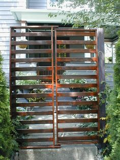 THAT IS AWESOME!~Futon Frame turned into Garden Gate … Nifty reuse of a structural bed frame, salvaged by a clever DIYer from a neighbour who was throwing it out. The sturdy hinge between the two pieces made it a perfect candidate for a gate. Opens up c