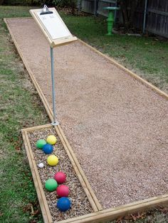 Learn how to build a backyard bocce ball court, complete with a ball holder and scoreboard, for hours of entertainment with step-by-step instructions and plans from HGTV.