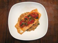 Adaptation of Epicurious Salmon with Roasted Tomatoes and Couscous  Quick and easy recipe....Very Good